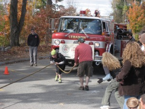 this is me, pulling a fire truck. i am the only one pulling, but i am not alone.